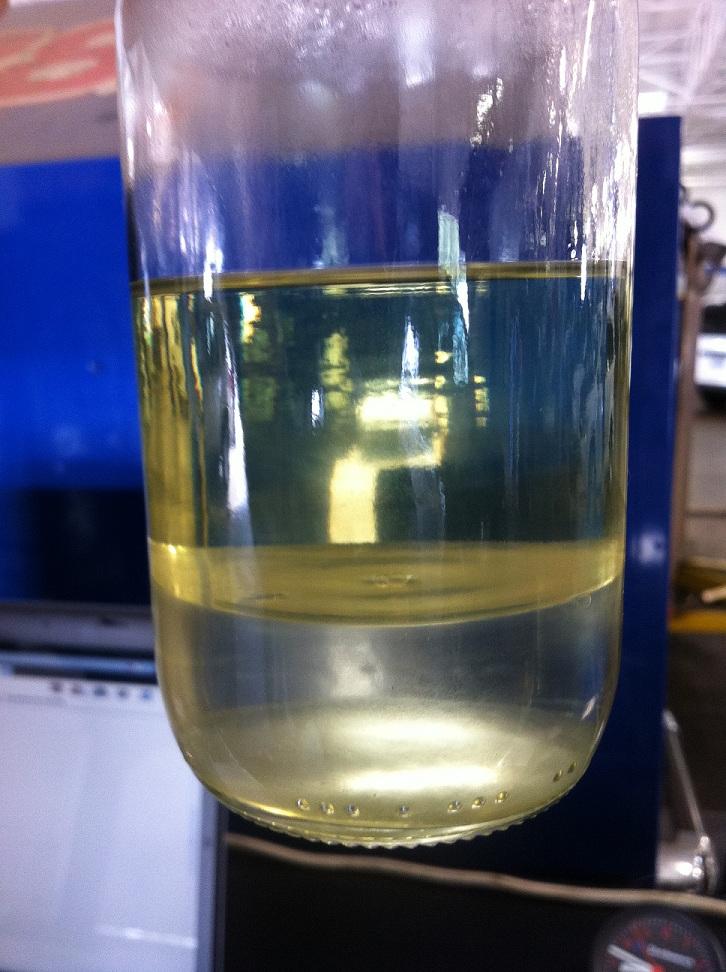 Contaminated gasoline that has separated.