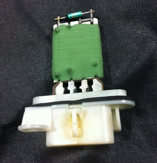Picture of a new blower motor resistor assembly. This part fixes most problems with your heater fan speeds  not working.