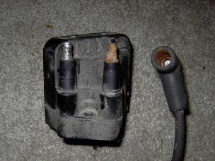 GM ignition coil with one corroded tower.
