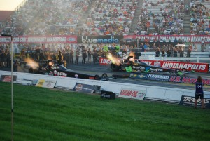 NHRA Top Fuel dragsters at night with fire