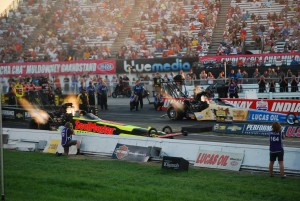 NHRA Top Fuel dragsters at night fire