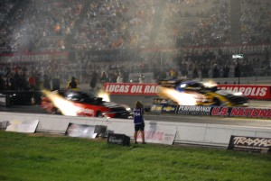 NHRA Funny Car at night with fire